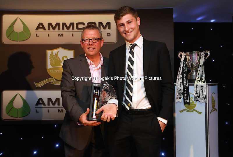 Thursday 16 May 2013<br /> Pictured L-R: Marty Morgan presenting Ben Davies with award.<br /> Re: Swansea City FC footballer of the year awards dinner at the Liberty Stadium.