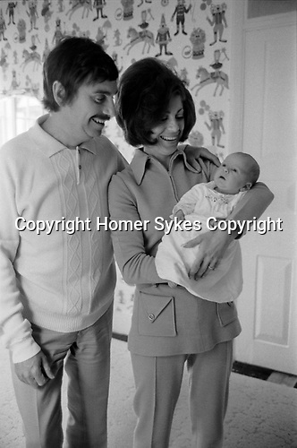 Leslie Thomas, OBE (22 March 1931 – 6 May 2014) was a Welsh author best known for his comic novel The Virgin Soldiers. At home in Berkshire 1971 with Diana Miles his wife and new son.