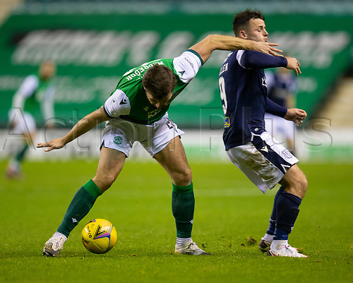 15th November 2020; Easter Road, Edinburgh, Scotland; Scottish League Cup Football, Hibernian versus Dundee FC; Melker Hallberg of Hibernian challenges for the ball with Danny Mullen of Dundee