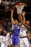 Kentucky forward Bobby Perry (13) shoots past Connecticut forward Denham Brown (33) and center Hilton Armstrong (11).  Connecticut defeated Kentucky 87-83 in the second round of the NCAA Tournament  at the Wachovia Center in Philadelphia, Pennsylvania on March 19, 2006.