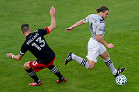 WASHINGTON, DC - NOVEMBER 8: Frederic Brillant #13 of D.C. United defends Samuel Piette #6 of the Montreal Impact during a game between Montreal Impact and D.C. United at Audi Field on November 8, 2020 in Washington, DC.