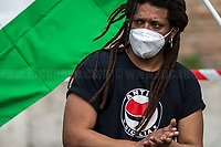 """Rome, Italy. 02nd June, 2021. On the day which marks the """"Festa Della Repubblica"""" (Italian Republic Day, 1.), Black Lives Matter Roma - supported by Rete G2 Seconde Generazioni and other Citizenship and Human Rights Organizations - held a demonstration in Piazza della Bocca Della Verità (2.) for a correct application of the current Citizenship Law (Article 4 of the Law n.91, 5 February 1992), for citizens' rights, and against discriminatory and racist language. From the organisers Facebook event page: «[…] We are mobilizing to ask for a correct and complete application of the current Citizenship Law - while still waiting for a proper reform of it - which implies that every Municipality of Italy notifies the possibility of acquiring citizenship to all the people born in Italy of foreign parents, without incurring serious defaults / non-fulfillment. We are mobilizing to ensure that the institutions abide by the Constitution and commit themselves to eliminating all obstacles of an economic and social nature that limit the freedom of people, as well as severely limiting access to the fundamental principles, and compromising the full development of human person and effective participation in the political, economic and social life of our country. We are mobilizing because the racist and discriminatory language used by the main Italian media is no longer acceptable. We want the media to be able to re-establish a representation of real society, involving the plurality of individuals who live with it […]».<br /> <br /> Footnotes & Links:<br /> 1. http://bit.do/eT8By (ITA) & http://bit.do/eT8Bv (ENG) <br /> 2. http://bit.do/fQX93 <br /> BLM Roma main demos:<br /> 07.06.2020 - Black Lives Matter Rome - Demo in Piazza Del Popolo http://bit.do/fQYdG<br /> 28.02.2021 - Black Lives Matter Rome: Demo in Piazza Del Popolo #diversədachi http://bit.do/fQYdE"""