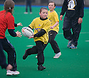 PUPILS FROM ST FRANCIS (yellow) AND DEAN PARK   (red) PRIMARY SCHOOLS TAKE PART IN THE TOUCH WORLD CUP YOUTH FESTIVAL AT PEFFERMILL.