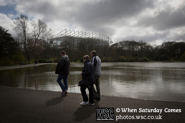 Newcastle United 1 Tottenham Hotspur 3 19/04/2015. St James Park, Premier League. Three supporters making their way to the game in Leazes Park, situated behind the Leazes Stand of the stadium before Newcastle United host Tottenham Hotspurs in an English Premier League match at St. James' Park. The match was boycotted by a section of the home support critical of the role of owner Mike Ashley and sponsorship by a payday loan company. The match was won by Spurs by 3-1, watched by 47,427, the lowest league gate of the season at the stadium. Photo by Colin McPherson.