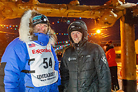 Geir Idar Hjelvik poses with Dallas Seavey, from whom he leased his dog team, at the finish line in Nome after arriving in 45th place during the 2017 Iditarod on Friday March 17, 2017.<br /> <br /> Photo by Jeff Schultz/SchultzPhoto.com  (C) 2017  ALL RIGHTS RESERVED