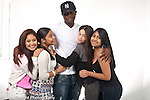 High school seniors informal portraits tall male student with group of shorter female students