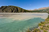 Confluence of the freshwater phelan creek and the glacial fed delta river, Alaska Range mountains, Interior, Alaska.