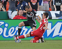 DC United captain and midfielder Ben Olsen (14) works to keep the ball while being tackled by Chicago Fire defender Gonzalo Segares (25). DC United defeated the Chicago Fire 3-1, at RFK Stadium in Washington DC, Saturday June 16, 2007.