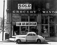 "Following evacuation orders, this store was closed.   The owner, a University of California graduate of Japanese descent, placed the ""I AM AN AMERICAN"" sign on the store front the day after Pearl Harbor.  Oakland, CA, April 1942.  Dorothea Lange. (WRA)<br /> Exact Date Shot unknown<br /> NARA FILE #:  210-G-2A-35<br /> WAR & CONFLICT #:  772"