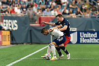 FOXBOROUGH, MA - AUGUST 18: Joseph Mora #28 of D.C. United attempts to control the ball as Tommy McNamara #26 of New England Revolution pressures during a game between D.C. United and New England Revolution at Gillette Stadium on August 18, 2021 in Foxborough, Massachusetts.