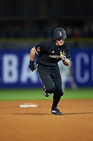 Jake Snider (20) of the Louisville Cardinals takes off for third base against the Notre Dame Fighting Irish in Game Eight of the 2017 ACC Baseball Championship at Louisville Slugger Field on May 25, 2017 in Louisville, Kentucky. The Cardinals defeated the Fighting Irish 10-3. (Brian Westerholt/Four Seam Images)