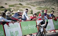Ben O'Connor (AUS/Dimension Data) handing his bidon to some fans in the race finale towards the finish (at almost 2000m alt.)<br /> <br /> Stage 5: L'Eliana to Observatorio Astrofísico de Javalambre (171km)<br /> La Vuelta 2019<br /> <br /> ©kramon