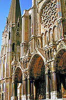 Chartres Cathedral with triple-arched doorways in Gothic style.