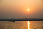 Boat at sunrise on the Ganges River in Varanasi, Uttar Pradesh, India.