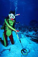 Scuba diver using underwater metal detector, treasure hunting, Turks and Caicos Islands..