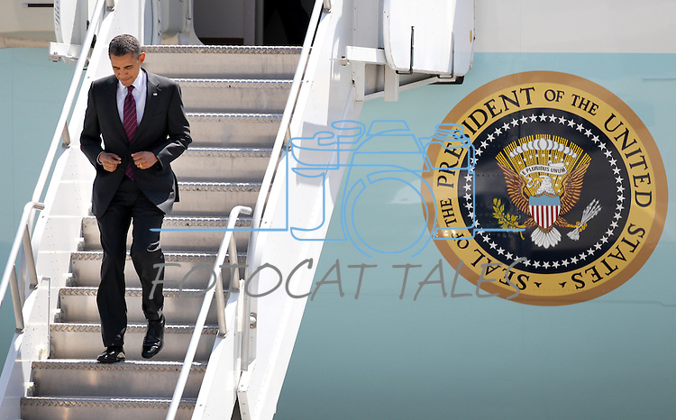 President Barack Obama lands at the Reno-Tahoe International Airport, in Reno, Nev. on Friday, May 11, 2012. (AP Photo/Cathleen Allison)