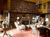 The small library also serves as Lord March's study and has a gallery floor