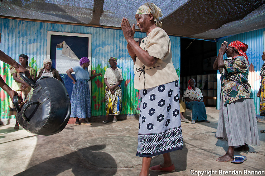 Grandmothers,w ho range in age from thier 60's to 80's practice self-defence kicks in a calss held regularly in Nairobi's Korogocho slum.