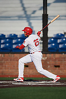 Johnson City Cardinals designated hitter Dariel Gomez (25) follows through on a swing during a game against the Danville Braves on July 29, 2018 at TVA Credit Union Ballpark in Johnson City, Tennessee.  Johnson City defeated Danville 8-1.  (Mike Janes/Four Seam Images)