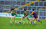 Kerry's Emma Dineen about to lay off a pass to team mate Kaykeigh Cronin as Roisin Murphy bears down on her, in the Lidl LGFA National football league game in Fitzgerald Stadium Killarney on Sunday.