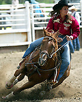 Womens Professional Rodeo Association cowgirl Mandy Teichert of Torrington, Wyoming eases her horse around the barrels during action at the annual Father's Day Rodeo June 15, 2008 in Evergreen, Colorado.
