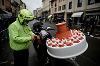the water-bottle-man getting ready at the race start in rainy Piacenza<br /> <br /> 104th Giro d'Italia 2021 (2.UWT)<br /> Stage 4 from Piacenza to Sestola (187km)<br /> <br /> ©kramon