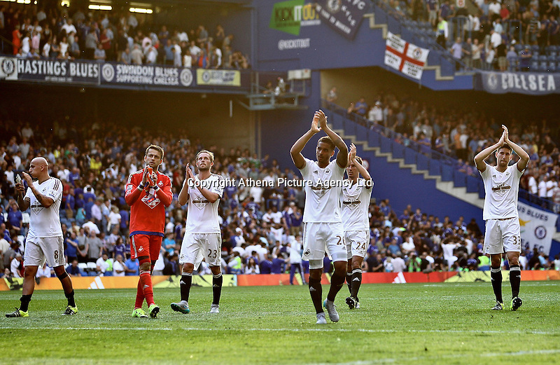 Lukasz Fabianski of Swansea and his team mates applaud the fans after the match   during the Barclays Premier League match between  Chelsea and Swansea  played at Stamford Bridge, London
