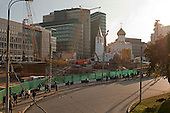 Moscow, Russia<br /> September 16, 2009<br /> <br /> New office buildings at the Belaruski train station tower above employees heading to work at morning rush hour. The buildings were designed by architect Boris Levyant and mark the change of the new Moscow landscape.