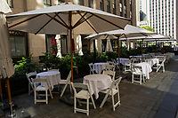 NEW YORK , NY JUNE 16:Empty tables are seen at  the Rockefeller center as the city mark the end of the COVID-19 restrictions in  New York on June 17 2021. <br /> (Photo by Kena Betancur/VIEWpress)