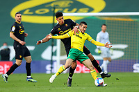 20th April 2021; Carrow Road, Norwich, Norfolk, England, English Football League Championship Football, Norwich versus Watford; Emi Buendia of Norwich City is under pressure from Adam Masina of Watford