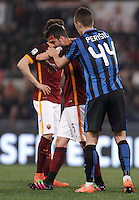 Calcio, Serie A: Roma vs Inter. Roma, stadio Olimpico, 19 marzo 2016.<br /> Roma's Miralem Pjanic, left, is helped by FC Inter's Ivan Perisic after getting injured during the Italian Serie A football match between Roma and FC Inter at Rome's Olympic stadium, 19 March 2016. The game ended 1-1.<br /> UPDATE IMAGES PRESS/Isabella Bonotto