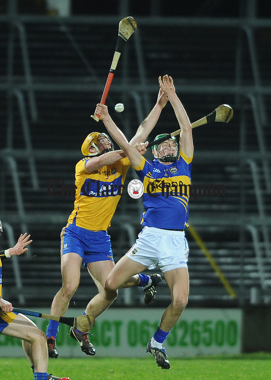 Cian Dillon of Clare in action against Paddy Murphy of Tipperary during their Waterford Crystal Final at The Gaelic Grounds. Photograph by John Kelly.