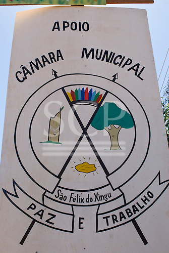 """Pará State, Brazil. São Félix do Xingu. Logo of the town; rubber tapping, forests, gold and Indians with motto """"Paz e Trabalho"""" (Peace and Work)."""