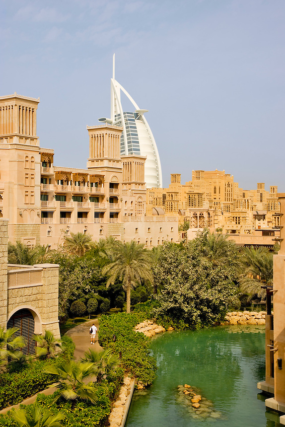 Dubai.   Al Qasr Hotel, Malakiya Villas and Burj al Arab Hotel seen over the Madinat Jumeirah. .
