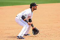 Wisconsin Timber Rattlers third baseman Gabriel Garcia (4) gets into defensive position during a Midwest League game against the Lansing Lugnuts on May 8, 2018 at Fox Cities Stadium in Appleton, Wisconsin. Lansing defeated Wisconsin 11-4. (Brad Krause/Four Seam Images)