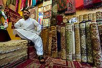 Carpet merchant in a Dubai Souk.