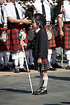 A young drum major pauses in the Grand Parade of Clans at the Scotsfest Scottish Festival and clan gathering at the Queen Mary in Long Beach, CA