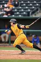 Jacksonville Suns  catcher J.T. Realmuto (11) at bat during a game against the Pensacola Blue Wahoos on April 20, 2014 at Bragan Field in Jacksonville, Florida.  Jacksonville defeated Pensacola 5-4.  (Mike Janes/Four Seam Images)
