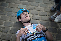 An exhausted Eli Yserbyt (BEL/U23/Marlux-Napoleon Games) has to lay down after finishing<br /> <br /> Brico-cross Geraardsbergen 2016