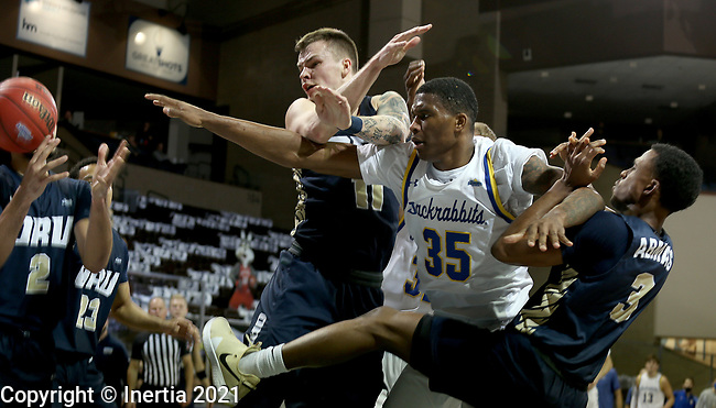 SIOUX FALLS, SD - MARCH 8: Douglas Wilson #35 of the South Dakota State Jackrabbits battles for the ball with Carlos Jurgens #11 and Max Abmas #3 of the Oral Roberts Golden Eagles during the Summit League Basketball Tournament at the Sanford Pentagon in Sioux Falls, SD. (Photo by Dave Eggen/Inertia)
