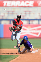 Frisco Rough Riders Odubel Herrera (16) attempts to turn a double play as Taylor Featherston (12) slides in during the first game of a doubleheader against the Tulsa Drillers on May 29, 2014 at ONEOK Field in Tulsa, Oklahoma.  Frisco defeated Tulsa 13-4.  (Mike Janes/Four Seam Images)