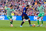 Lionel Andres Messi of FC Barcelona (C) competes for the ball with Jose Andres Guardado Hernandez (L) and Cristian Tello Herrera of Real Betis during the La Liga 2018-19 match between FC Barcelona and Real Betis at Camp Nou, on November 11 2018 in Barcelona, Spain. Photo by Vicens Gimenez / Power Sport Images