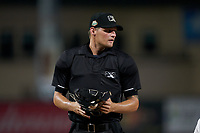 Umpire Justin Whiddon during a Florida State League game between the Clearwater Threshers and Palm Beach Cardinals on August 9, 2019 at Roger Dean Chevrolet Stadium in Jupiter, Florida.  Palm Beach defeated Clearwater 3-0 in the second game of a doubleheader.  (Mike Janes/Four Seam Images)