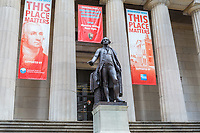 The statue of George Washington on the steps of historic Federal Hall in New York City.