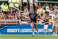 NEWTON, MA - MAY 22: Meaghan Scutaro #25 of Notre Dame brings the ball forward during NCAA Division I Women's Lacrosse Tournament quarterfinal round game between Notre Dame and Boston College at Newton Campus Lacrosse Field on May 22, 2021 in Newton, Massachusetts.