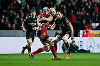 Friday 03 January 2014<br /> Pictured: Jake Ball  passes the ball back to Scott Williams of the Scarlets <br /> Re: Ospreys v Scarlets, Rabo Direct Pro 12 match at the Liberty Stadium Swansea, Wales