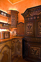 A large hand-painted dresser and a wall-mounted corner cupboard provide ample storage in the kitchen