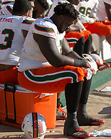 Miami defensive lineman Kendrick Norton sits on the bench while his team is being upset. The Pitt Panthers upset the undefeated Miami Hurricanes 24-14 on November 24, 2017 at Heinz Field, Pittsburgh, Pennsylvania.