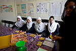 16 June 2013, Qala Wazir, Khoshal Khan, Kabul Province,  Afghanistan.  Students (from left)  Rafia Hotak 16, Washma Anifi 15, Asma Monsri 15, and Halima Halimi 16 during a physics class  with teacher Zheela Zohel at Shahid Nahid High School in Kabul.   Much of the funding for the school, including construction, was provided by the Education Quality Improvement Program (EQUIP). The school is benefitting from EQUIP whose objective is to increase access to quality basic education, especially for girls. School grants and teacher training programs are strengthened by support from communities and private providers.  Picture by Graham Crouch/World Bank