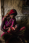 Srikanthi Devi feeds her son in the kitchen of her house in Ramgarwa village in Raxaul district in Bihar, India.
